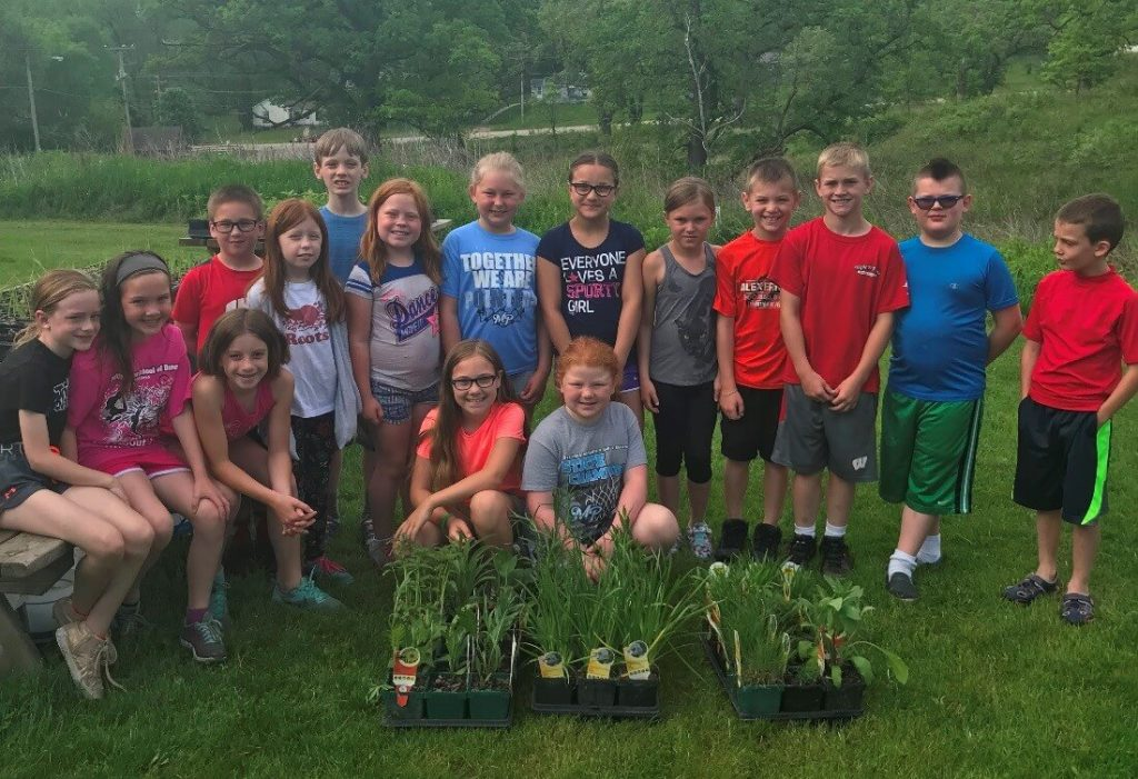 3rd graders with native plants for Don Hawkins Oak Savanna