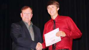 Student receiving scholarship award