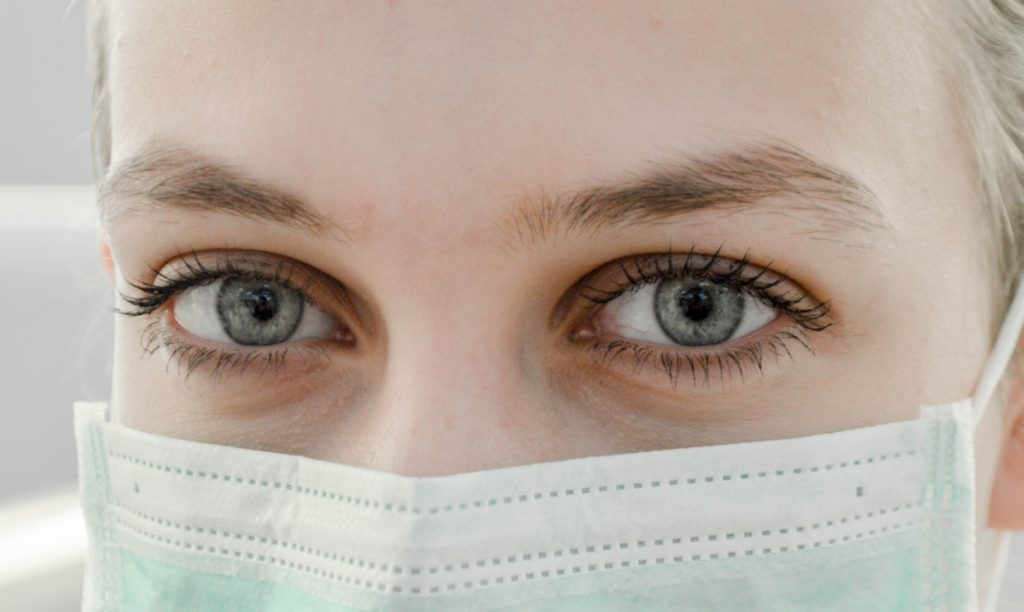 Adult wearing medical mask